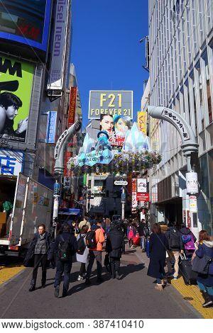 Tokyo, Japan - December 3, 2016: People Visit Center Gai Shopping Street In Shibuya, Tokyo. Tokyo Is