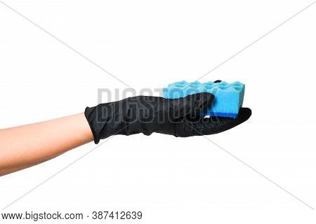 Hand In A Black Glove Holds A Sponge For Washing Dishes