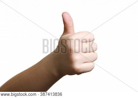 Closeup Of Kids Hand Showing Thumbs Up Sign