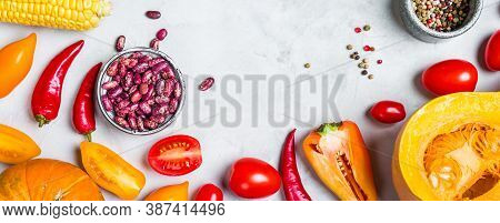 Fresh Orange Vegetables On A Gray Background. Food Background