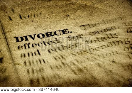 Symbol of broken marriage with word and definition of divorce