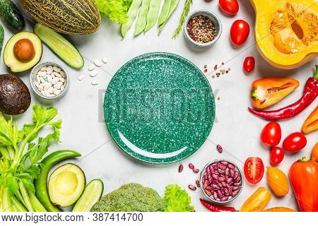 Fresh Vegetables Frame With Ceramic Plate In The Middle