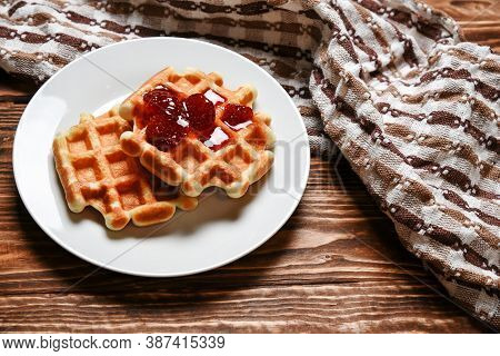 Waffles With Strawberry Jam On Wood Table Over Head View