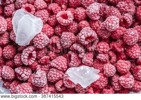 Large Beautiful Frozen Raspberries Close Up. Concept Of Frozen Food, Long Term Storage Products