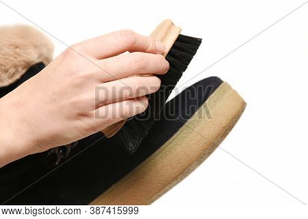 Shoe Cleaning, Shoe Care. Girl Hand Brushing Shoes Close-up