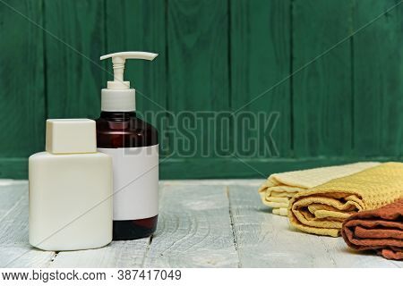 Jar And Bottle Cosmetics With Towel On A Wooden Shelf Still Life