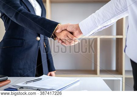 Greeting New Colleagues, Handshake While Job Interviewing, Female Candidate Shaking Hands With Inter