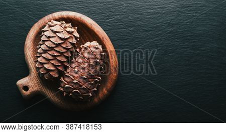 Siberian Cedar Cones On A Black Background. Natural Products