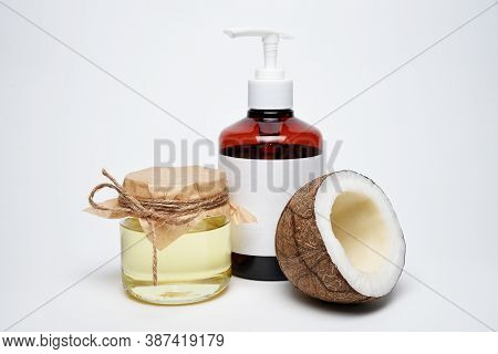 Organic Natural Cosmetic Coconut Oil With Flask On White Background.