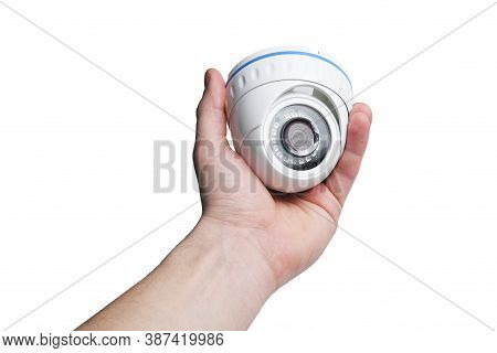 Installation Of A Cctv Camera. Dome Security Round Surveillance Camera In The Hands Of A Man.