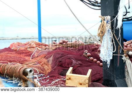 Fishing Nets And Tackle On A Ship, Fishing Boat. Fisher Boats With Nets Long Lines Buoy Tackle