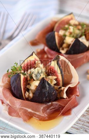 Figs Stuffed With Blue Cheese, Wrapped In Parma Ham, Drizzled With Honey