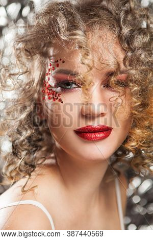 Young Woman With Shiny Lips And Gorgeous Beautiful Curly