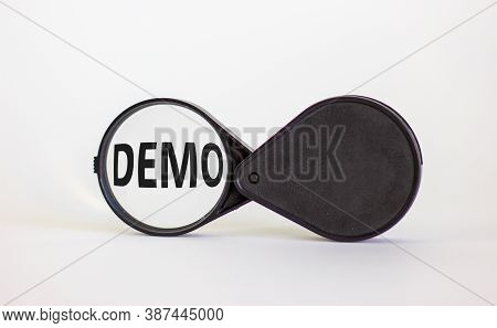Magnifying Glass With Word Demo On Beautiful White Background. Business Concept, Copy Space.