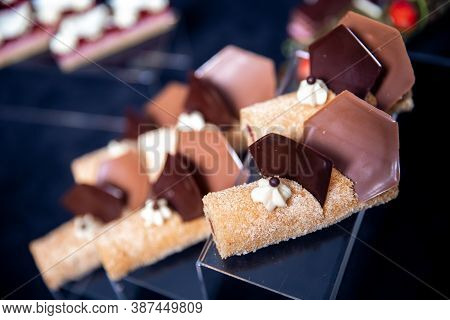Close Up Of Honey Cake Dessert With Chocolate Decor And Meringue, Gourmet Catering Sweet