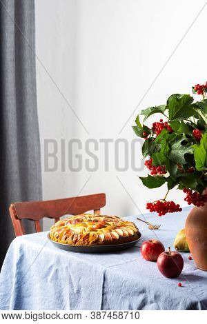 Delicious Apple Pie, Home Interior, Table With Blue Tablecloth, Clay Vase With Viburnum And Fruits