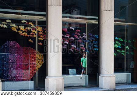 Barcelona, Spain - June 2, 2013: Contemporary Gallery Showcase With Rainbow Fish.
