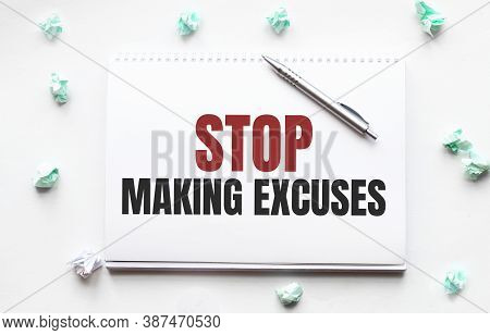 Blank Sheet, Pen And Crumpled Paper Balls On Grey Table, Flat Lay. Text Stop Making Excuses