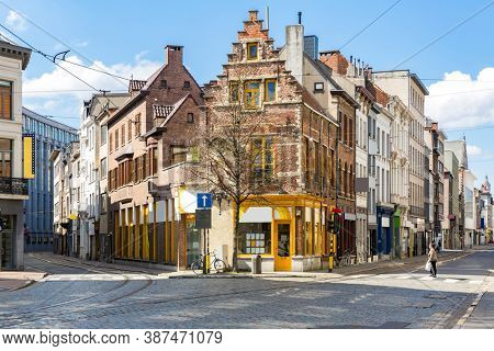 Cityscape of Meir shopping street road in Antwerp downtown in Belgium with tram track. EU Belgium city landmark and shopping center for tourism and travel destination concept.