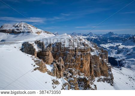 View of a ski resort piste and Dolomites mountains in Italy from Passo Pordoi pass. Arabba, Italy