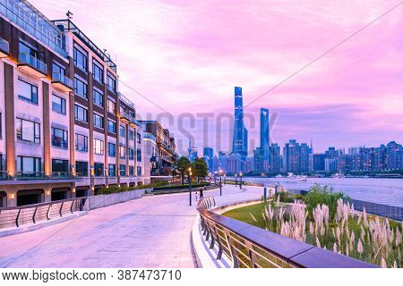City skyline at dusk,Pudong's Lujiazui Financial and Trade Zone. Viewed from a footpath by the Huangpu river.