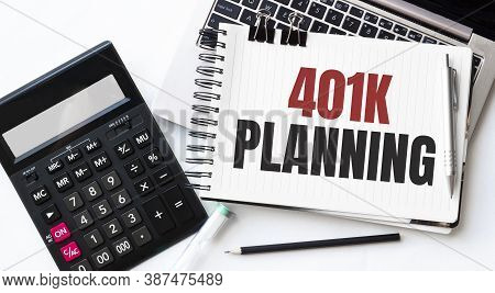 Keyboard Of Laptop, Calcualtor, Pencil And Notepad With Text 401K Planning On The White Background