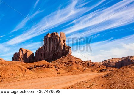 Huge rock Elephant in Monument Valley. The rocks - outcrops made of red sandstone. Flying clouds on the red stone valley. The concept of active, environmental and photo tourism