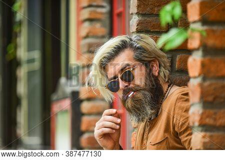 Went On Smoke Break. Hipster Smoking Irish Pub Entrance Background. Smoking Habit. Brutal Guy Sungla