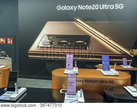 Darmstadt, Germany - 17th August 2020: A German Photographer Visiting A Samsung Storel, Viewing The