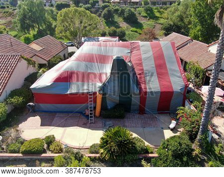 Aerial View Of Villa Covered With A Red And Green Tent While Being Fumigated For Termites, Rancho Be