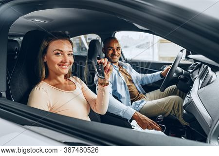 Happy Excited Couple Buying A New Car And Showing Keys