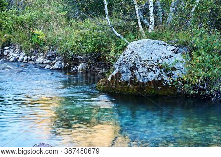 Stream Pool On A Small Mountain River With A Beautiful Rock With Birches On The Bank