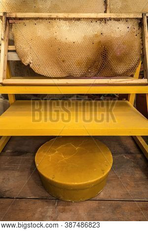 Beekeeper's Tools, Honeycomb And Wax Beautiful Yellow Rustic Background. The Empty Space On The Wood