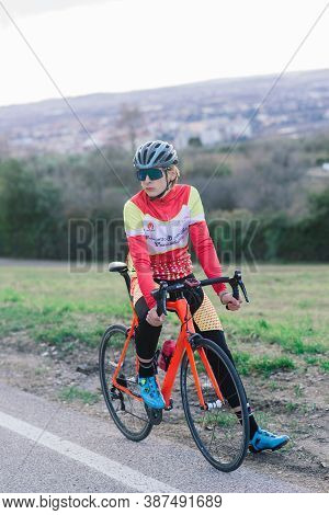 Professional Athlete Cyclist Riding Racing Bike In Competition On Open Road.