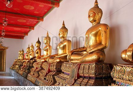 Golden Buddha Is In A Asian Temple. Statues Of Golden Buddha In Thailand.