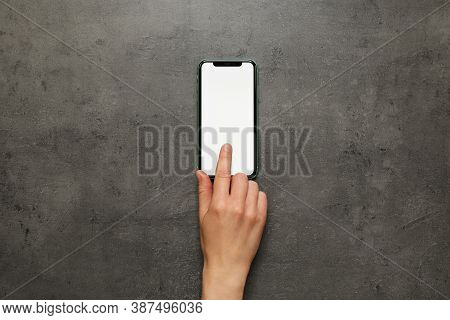 Mykolaiv, Ukraine - July 07, 2020: Woman Using Iphone 11 On Grey Background, Top View. Mockup For De