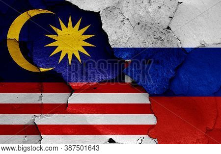 Flags Of Malaysia And Russia Painted On Cracked Wall
