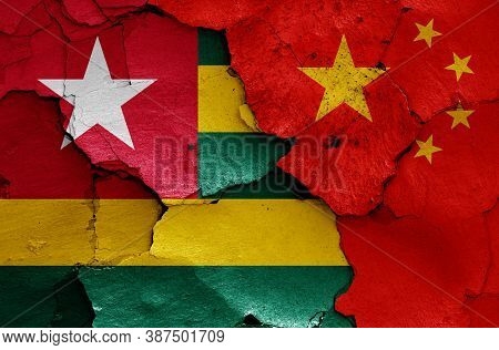 Flags Of Togo And China Painted On Cracked Wall