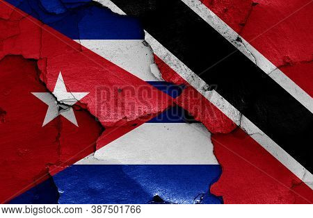 Flags Of Cuba And Trinidad And Tobago Painted On Cracked Wall