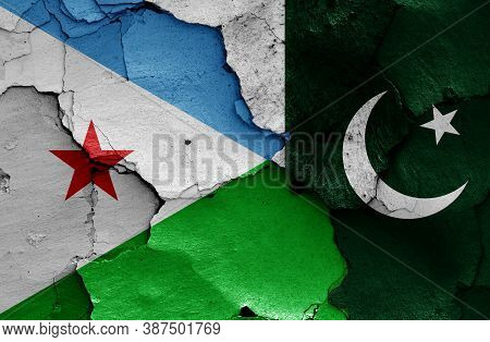 Flags Of Djibouti And Pakistan  Painted On Cracked Wall