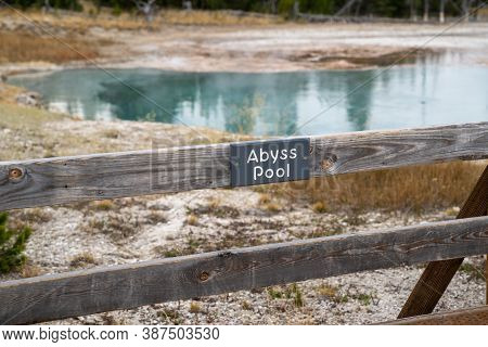 Sign For Abyss Pool, A Thermal Feature In The West Thumb Geyser Basin Of Yellowstone National Park