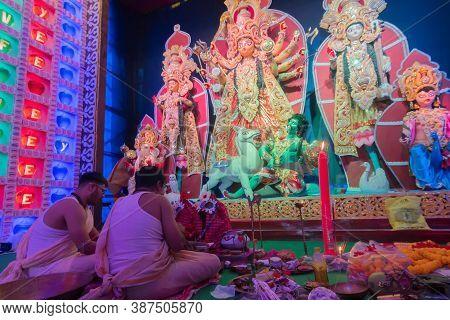 Howrah, West Bengal, India - 5th October 2019 : Hindu Bengali Purohits Chanting Sanskrit Shlokas In