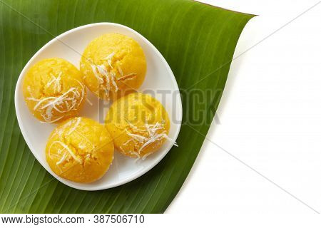 Toddy Palm Cake Is Thai Dessert In White Plate Placed On Banana Leaf Isolated On White Background In