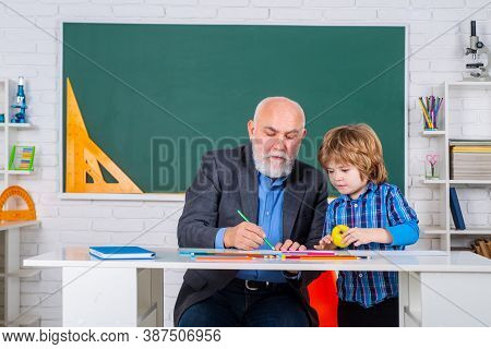 Individual Teaching. Professor And Pupil In Classroom At The Elementary School. Pupil Study At Schoo
