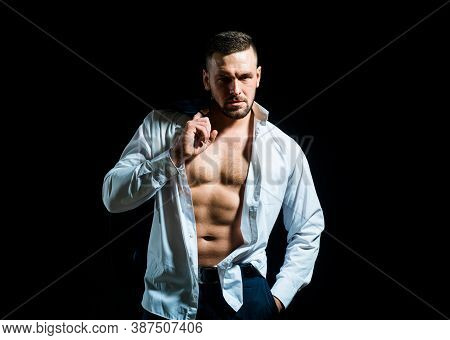 Man Undressed Shirt. Sexy Man With Muscular Body And Bare Torso