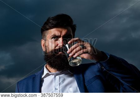 Luxury Rich Bearded Man Drink Expensive Beverage. Man With Beard Holds Glass Brandy, Drink Cognac. G