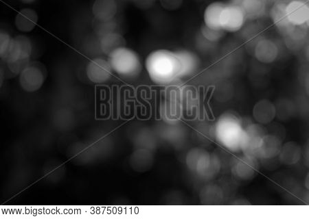 Dark Blurred Christmas Lights Background. Design Effect Focus Happy Holiday Party Glow Texture Black
