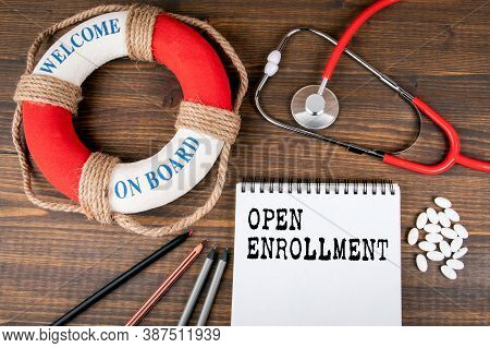 Open Enrollment. Lifebuoy With Text And Doctors Stethoscope