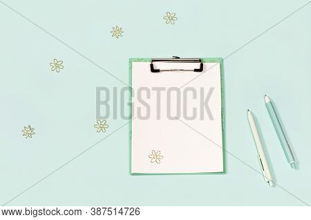 Paper Tablet With Clip And Stationery. Back To School Concept. Blue And White Colored Pens, And Mode