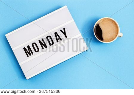 Text Monday On Lightbox And Cup Of Coffee For Holiday - Thank God Its Monday. Start Of Working Week